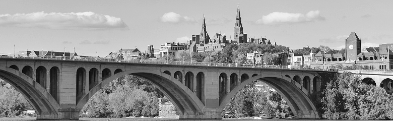 B/W photo of Georgetown University with Key Bridge in the foreground